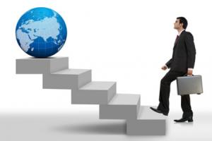 Man-Walking-Up-Stairs-to-Globe